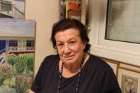 Ruth Federmann with her paintings