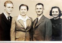 With her parents and brother after the war
