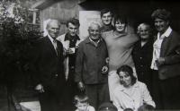 A wider family on the father's side. The father in the middle, granny wearing a black blouse; Masákova Lhota (Prachatice district); not earlier than 1960