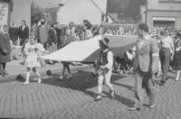 The parade in basketball in 1948. Blanka Andělová carries Slovácké costume Czechoslovak flag