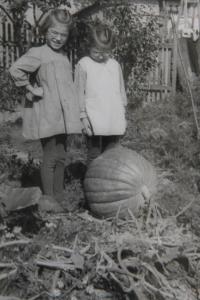 Zdena a Eva in their family house garden