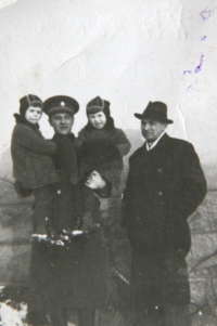 the twins with their father, Mr. Ruzicka, and their tenant holding the girls