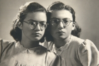 with her twin sister Eva