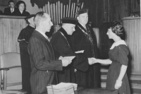 Zdena' s graduation in December 1961 with professor Hrůza shaking hands and rector Kudrna on his left