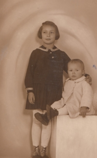 With her brother Karel in 1935