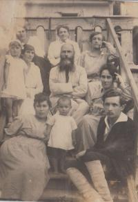 Historical photo, his mother Marie in the front