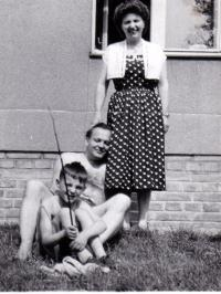 In front of his house at Roztoky with his wife and son, 1958