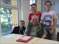 Students Martin Krejčí, Matěj Hodoval and Timothy Alex Starý with witness