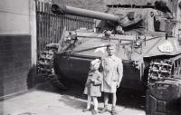 Pavel Bartovský with his sister in front of american tank, 1945