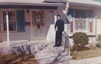 """1963 - San Antonio, Texas: """"This photo is of me taken at Christmas. It is the house of a Polish family, where I was at lunch. On the door is a package on the windows the candles. It's a christmas decoration. See it's mainly in the evening when it is illum"""