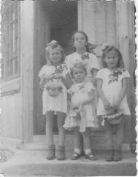 Kristina, the smallest in the middle, on the feast of God's body with Polish little girls from the neighborhood, Wola Michowa, 1945