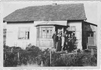 Kristina front of the house in the middle of family, friends and neighbors, Wola Michowa, 1945