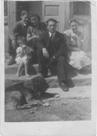 Kristina front of the house with her mother and relatives and a dog Burko, Wola Michowa, 1945