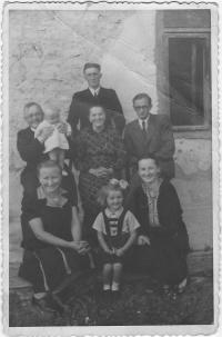 Kristina with her parents, uncles, aunt, grandmother and little cousin, Vydraň, July 22, 1946