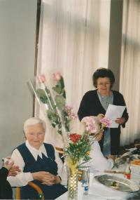 Kristina, with a sheet of paper in her hand, as a chairwoman of the Association of Ukrainian Women in Prague in 2003