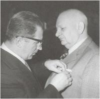 Father Vilém Nový receiving an award from the Prime Minister Lubomir Štrougal, 1984