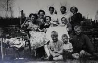 Anita with her family visiting Kraslice in 1956 (Anita holding a glas, Anita´s granny wearing a shawl)