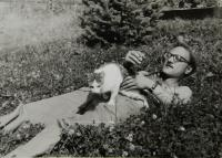 Jan Frolík with his neighbour´s cat in Rudník near Vrchlabí in 1982