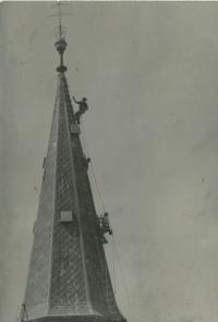 Vlastimil Bartos during the repair of the church roof in 1980s