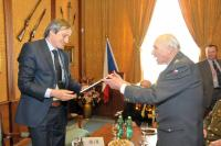 Colonel in retirement Pavel Vranský hands a book about czechoslovakian pilots who fought with the british R.A.F. to the Defence Secretary Martin Stropnický - The Ministry of Defence (2014)
