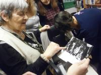 Ludmila Janská looking at historic theatre photographs, ABC Theatre 2016