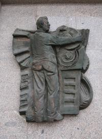 """Relief """"Modern production"""" on the building of Regional Committee of Communist Party in Pilsen, author: Alois Sopr"""