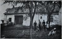 The mother of Irena Ondruchová, Marie Šimečková (2nd right) behind the house in Výškovice. Aunt Adámková lying in a grass in 1944