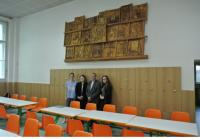Lumír Čmerda with pupils in front of relief that he made