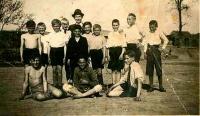 Bohuš sitting in the middle as a goalkeeper wih his football team, Hrušky 1934