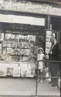 Hana and her father in front of the family shop in Holice.