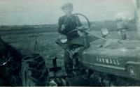 Milan Hlobílek at the Farmall tractor in 1945