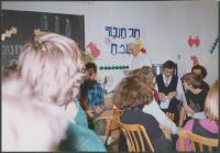 Mikuláš in the white kipa celebrating Chanuka at the Lauder Schools, Prague about 1998