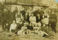 Music choir in the České Dorohostaje in Volhynia in 1946. Evženie Hajná is in the middle wearing a hat.
