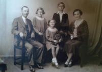 Jiřina Fořtová (in the middle with Teddy bear) with parents, brother Miroslav and sister Věra
