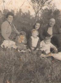 Mother, father and kids, grandmother Ranka, in the orchard of a family house in Petrovaradin/Srbija,1959