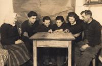 The Kovalčuk family listening to radio during WW II.