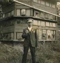 František Horn in front of bee house