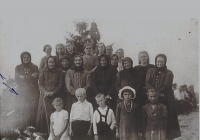 A group of women and children who survived the burning of Bohemian Malina