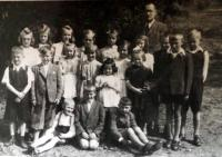 Marie (third from left, back row) in a school photo, Encovany 1946
