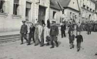 Václav Holba in the white coat right, May Day procession 1945, Valašské Klobouky