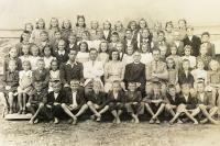 left behing the teacher Miss Horáková, 1st year high school, Brumov 1945