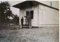 Soukup family in front of their temporary home
