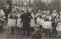 Antony in the folk costume, in the back in the middle, holding a child's hand, date unknown