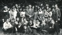 Béla (kneeling, first from the left) on a high school picture