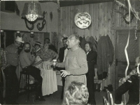 Bohumil Hrabal in the center of attention at the masquerade ball